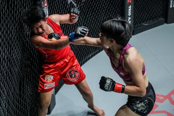 April Osenio, Xiong Jing Nan