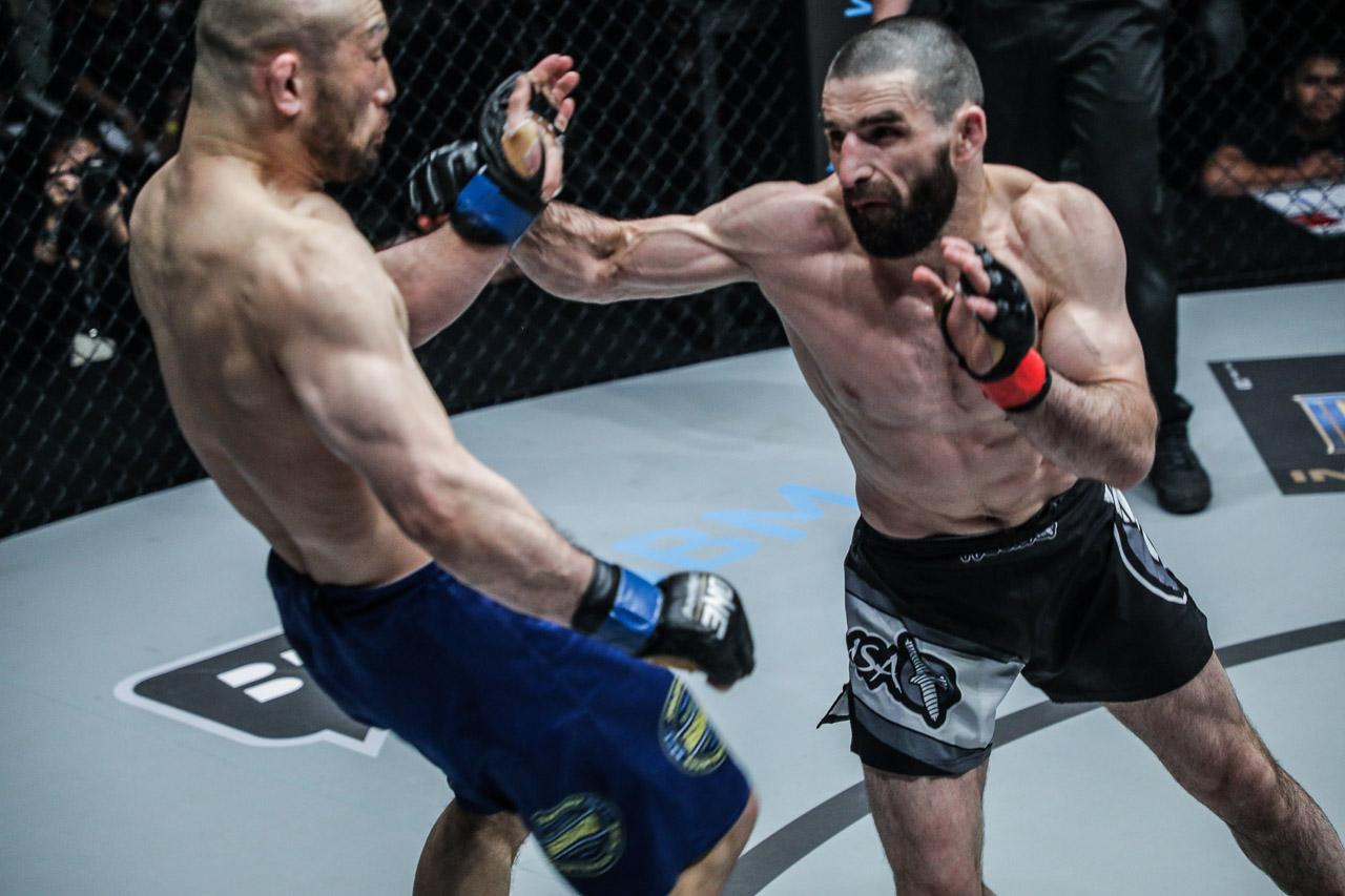 Yusup Saadulaev punching Masakazu Imanari