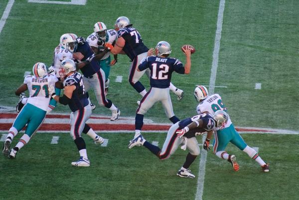 Tom Brady and the Miami Dolphins (©Paul Keleher)